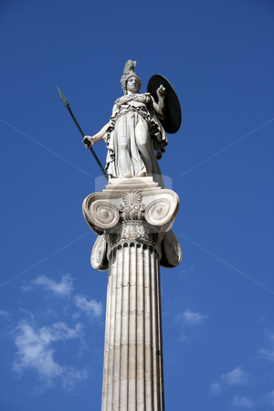Athena on pillar stock photo, The statue of goddess athena on a tall corinthian pillar in front of the university of athens greece on total blue sky background by EVANGELOS THOMAIDIS