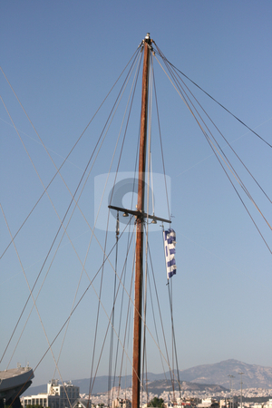 Sailboat mast stock photo, Sail and ropes with greek flag and athens city background by EVANGELOS THOMAIDIS