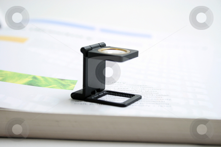 Loupe stock photo, Magnifying glass loupe graphic arts and printing concepts by EVANGELOS THOMAIDIS