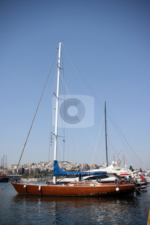 Sail yacht stock photo, Luxury sail yacht at marina and city view background at piraeus athens greece by EVANGELOS THOMAIDIS