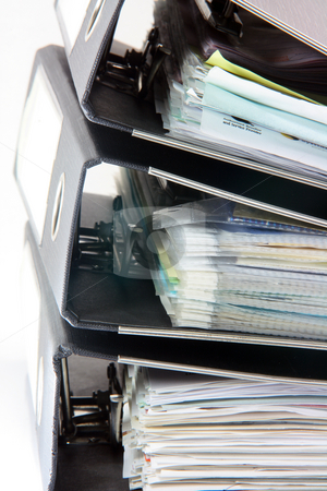 Stack of folders stock photo, Detail from stack of three black business folders on white by EVANGELOS THOMAIDIS
