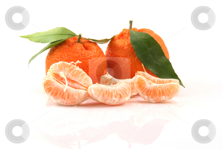 Slices of mandarin stock photo, Two mandarins with leaf and slices isolated on white background fruits and agriculture concepts by EVANGELOS THOMAIDIS