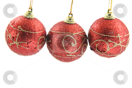 Three xmas balls stock photo, Three red christmas decoration balls hanging isolated on white background front view by EVANGELOS THOMAIDIS