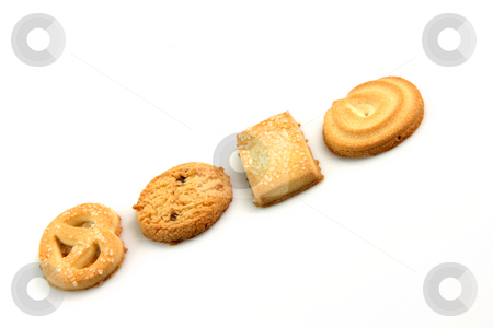Biscuits in row stock photo, Four biscuits in a row isolated on white background food and cookies concepts by EVANGELOS THOMAIDIS
