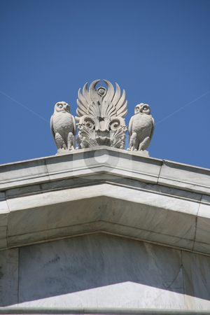 Owl statues stock photo, Neoclassical architecture details decoration owls statues on the roof by EVANGELOS THOMAIDIS