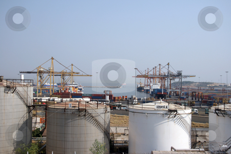 Chemical plant and port stock photo, Chemical tanks and cargo port transportation industry at the port of piareus athens greece by EVANGELOS THOMAIDIS