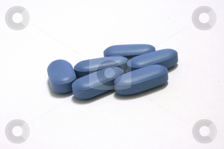 Blue pills bunched stock photo, Blue pills health and medicine concepts looks like viagra on white by EVANGELOS THOMAIDIS