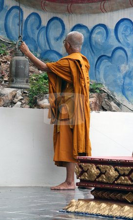 Monk ringing the bell stock photo, Buddhist monks ringing the bell at big buddha temple samui island thailand by EVANGELOS THOMAIDIS