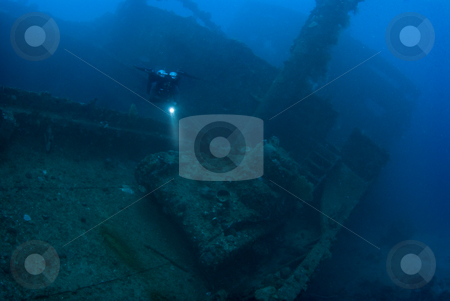 Diver with Tank stock photo, A diver hovering above a Japanese Type 97 light tank, which rests on the deck of the Nippo Maru; A Japanese cargo ship sank in during the World War 2 Operation Hailstone, February 1944, in Truk (Chuuk) Lagoon, Micronesia by A Cotton Photo