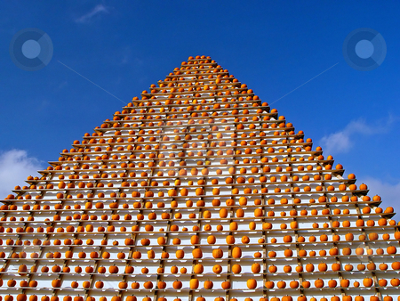 Pyramid of pumkins stock photo, A pyramid with hundreds of orange pumpkins on it. Picture taken at a pumpkin contest in the region of Z??rich, Switzerland by Emmanuel Keller