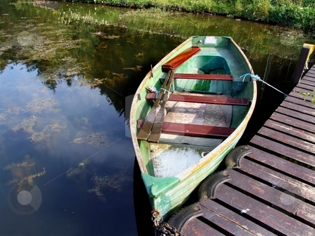 Fishing boats stock photo, Empty fishing boat on the lake by Juliet Photography