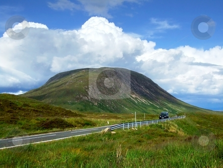 Going to Glencoe stock photo, The view of a car driving along Glencoe road by Juliet Photography