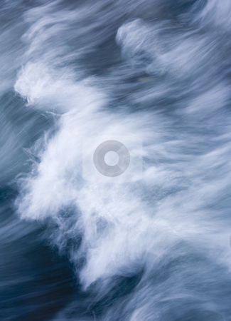 Storm Driven stock photo, A wave driven by the winds of a storm shot from above on the relatively safe haven a large rock provided. by Mike Dawson
