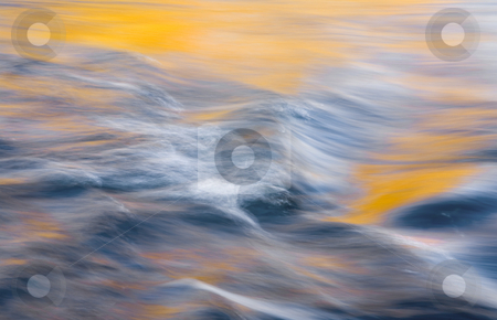 Ripples of Autumn stock photo, Ripples and rapids on the Yakima River on a cold October Morning with warm light creating the color on trees reflecting from the far bank. by Mike Dawson