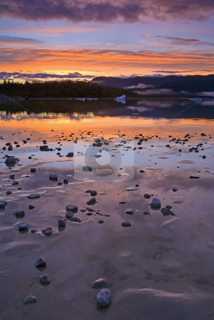 Left by the Ice stock photo, Stones and sand left by the receding Mendenhall Glacier glow in the light of the setting Sun by Mike Dawson