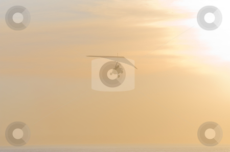Faded silhouette of a glider. stock photo, The faded silhouette of a motorized glider, disappearing into the sunset. by Nicolaas Traut
