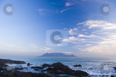 Table mountain Cape Town stock photo, Table Mountain - the world famous landmark in Cape Town, South Africa. Picture taken on a clear Winters day from the Blouberg Strand beach. A vivid blue sky looks spectacular behind clouds in the sunset. by Nicolaas Traut