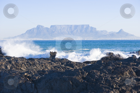 Table mountain Cape Town stock photo, Table Mountain - the world famous landmark in Cape Town, South Africa. Picture taken on a clear Winters day from the Blouberg Strand beach. A rocky part of the beach is in the foreground. by Nicolaas Traut