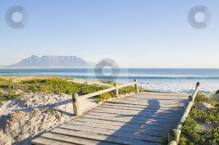 Table mountain Cape Town stock photo, Table Mountain - the world famous landmark in Cape Town, South Africa. Picture taken on a clear Winters day from the Blouberg Strand beach. A wooden bridge over a sanddune is in the foreground. by Nicolaas Traut