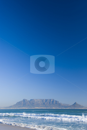 Table mountain Cape Town stock photo, Table Mountain - the world famous landmark in Cape Town, South Africa. Picture taken on a clear Winters day from the Blouberg Strand beach. Ample space on top for copy text. by Nicolaas Traut