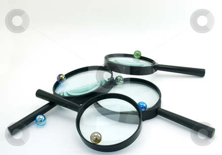 Magnifiers and Marbles stock photo,  by Sinisa Botas