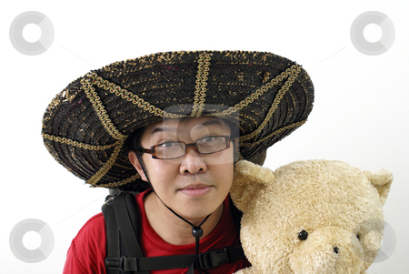 Asian tourist with teddy bear stock photo, Asian tourist with teddy bear. by Wong Chee Yen