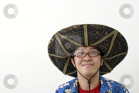 Asian man with mexican hat stock photo, Asian man with mexican hat by Wong Chee Yen