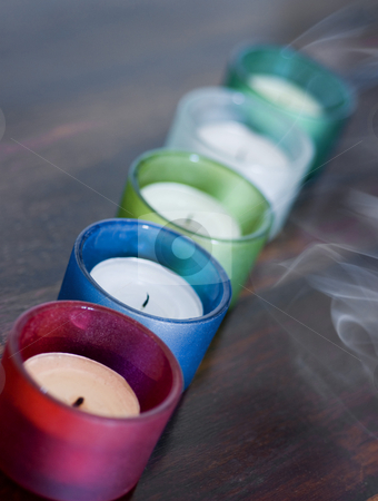 Extingusihed stock photo, 5 smoking candles just after being blown-out by Stephen Gibson
