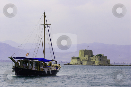 Boat with castle behind stock photo,  by John Tsilidis