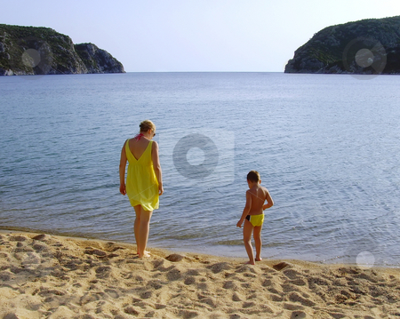 Beach walk stock photo, A mother and a son enjoying by the sea by Ivan Paunovic