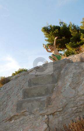Boy on a top stock photo, A boy on a top of the stairway by Ivan Paunovic
