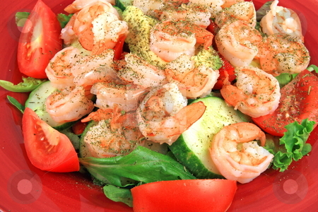 Seafood salad on red plate stock photo, Shrimp  salad with lettuce and tomato,avocado cucumberand sesoning on red plate by Jack Schiffer