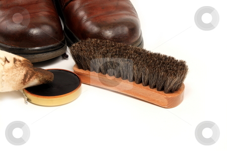 Shoe Shine stock photo, Polishing shoes with polish applicator and brush by Jack Schiffer