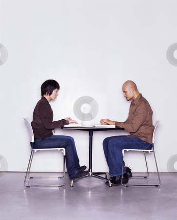 Couple telecommuting stock photo, Couple telecommuting by Mpixis World