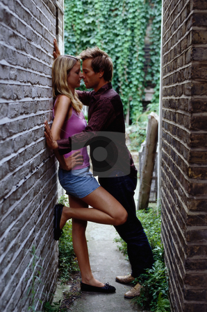 MPIXIS550431 stock photo, Couple kissing in alley by Mpixis World