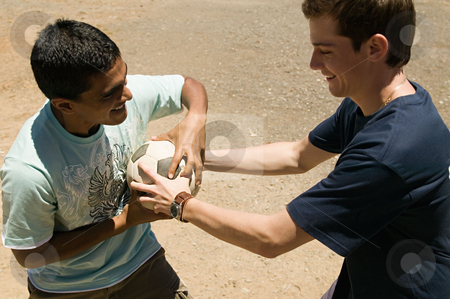 MPIXIS570141 stock photo, Young men fighting over a football by Mpixis World