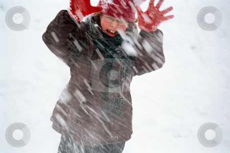 Snowball fight stock photo, Child fighting a snowstorm by Mpixis World