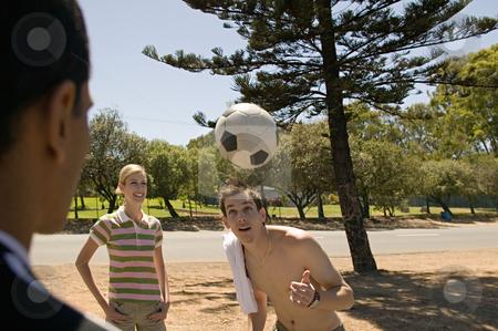 MPIXIS570128 stock photo, People watching man heading football by Mpixis World