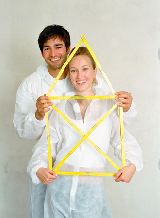 MPIXIS574007 stock photo, Couple holding house shaped frame by Mpixis World