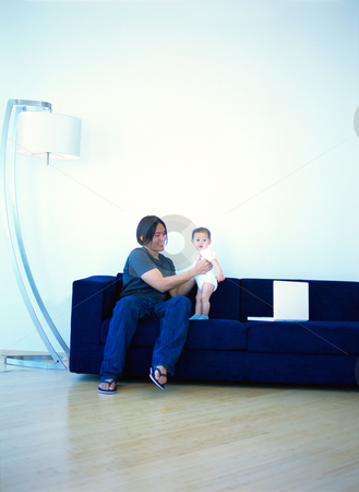 MPIXIS589030 stock photo, Father and baby on sofa by Mpixis World