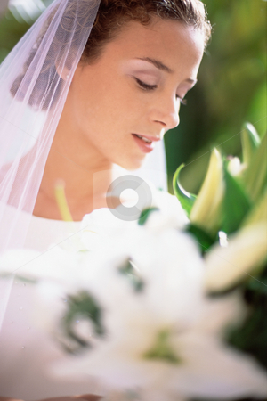 Bride at wedding stock photo, Bride holding bouquet by Mpixis World