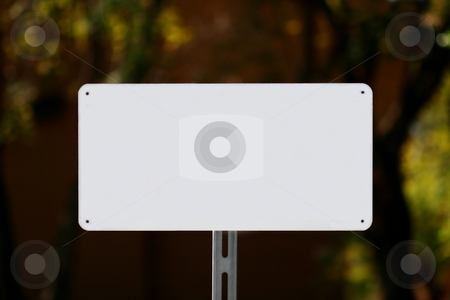 White Sign stock photo, White sign with a natural green and dark brown background. by Henrik Lehnerer