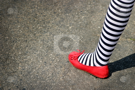 Dortheys foot from wizard of oz stock photo, Patriotic foot with red shoe and blue white striped sock or Dortheys foot from wizard of oz. by Henrik Lehnerer