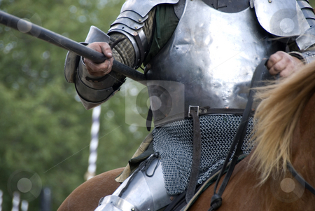 Knight's Lance stock photo, Stock photo of a close up of a knight's armor as he charges towards his opponent on his horse, lance in hand. by Maria Bell