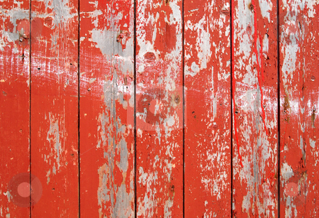 Red flaky paint on a wooden fence. stock photo, Red flaky paint on a wooden fence. by Stephen Rees