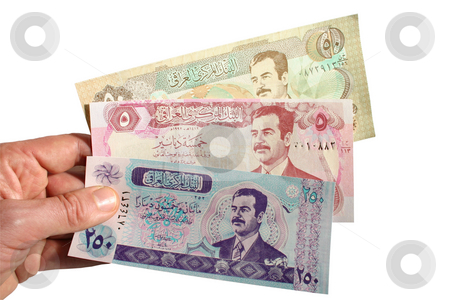 Paying with Iraqi Dinars stock photo, Paying with Iraqi Dinars by Stephen Rees