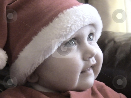 Christmas Theme - Christmas Baby  stock photo, This was a classic photo.  It is very warm and sums up Christmas in one.  It is a photo of my beautiful daughter, Grace, on Christmas morning. by ANDREW NORRIS