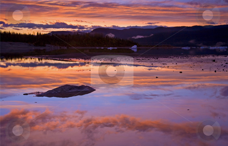Mendenhall Sunset stock photo, A colorful sunset over the water of Lake Mendenhall with small ice calved off the Mendenhall Glacier. by Mike Dawson