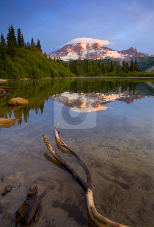 Capped Sunrise stock photo, Sunrise glows on the lenticular cloud capped peak of Mt. Rainier as it reflects in the still waters of Bench Lake by Mike Dawson