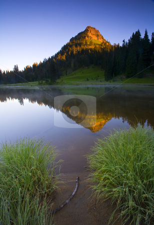 Hill reflection stock photo, Yakima Peak illuminated by dawns first light as a morning mist rises off the Lake Tipsoo by Mike Dawson